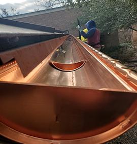 Installing a seamless copper gutter